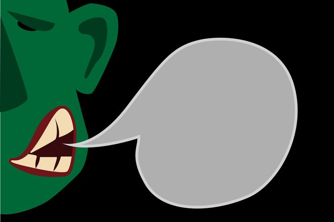 A green, illustrated, grumpy face with a gray speech bubble hanging out of the side of it's mouth.
