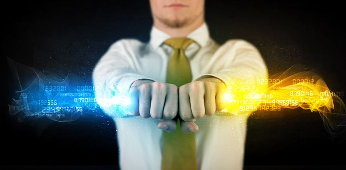 A business man holding a wand of blue and yellow light with data numbers running through it.