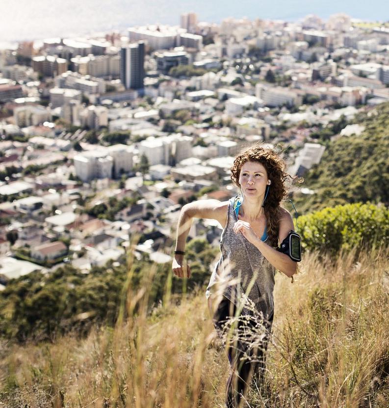 Woman running up hill