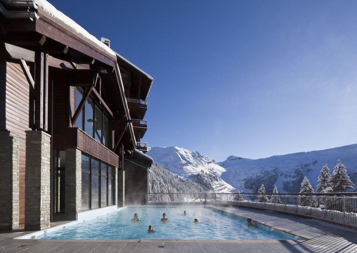 Résidence avec piscine à la montagne