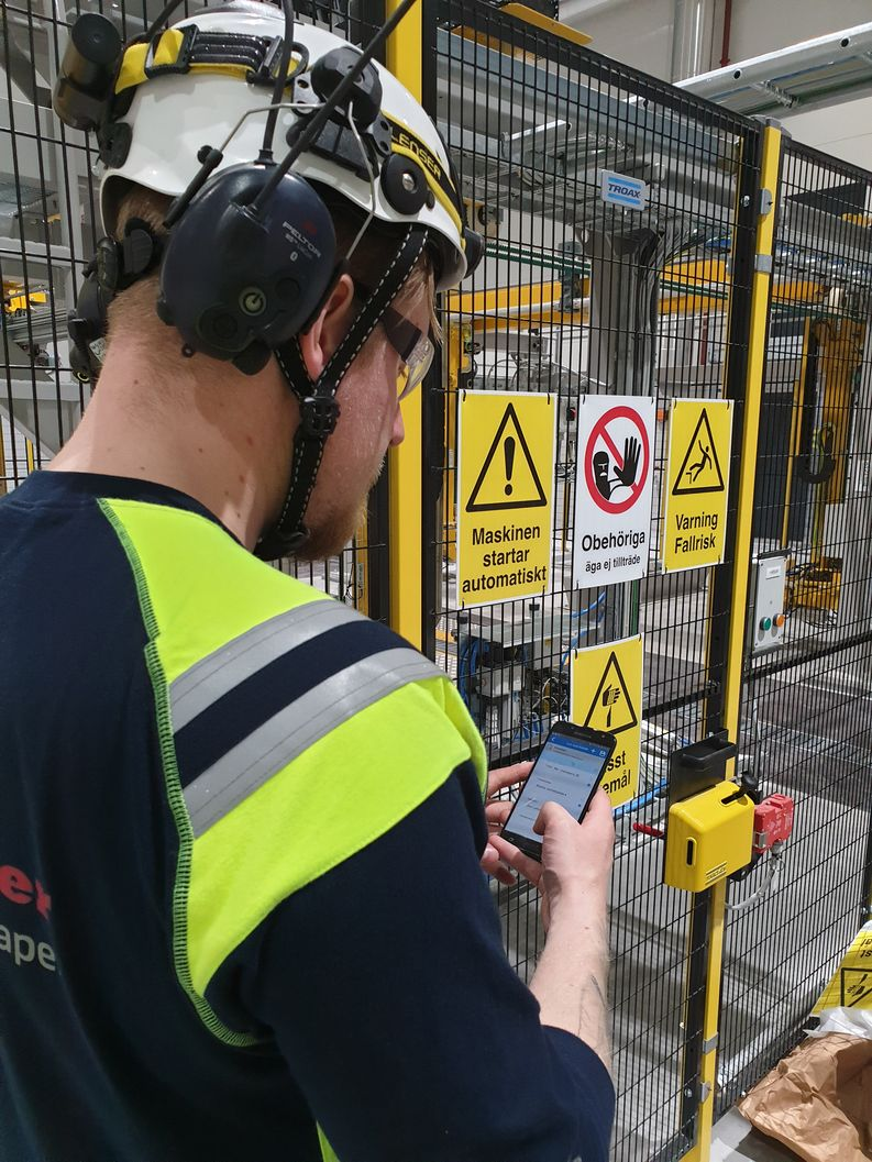 Raumaster Paper automation engineer Harri Honkanen completing a personal risk assessment on site