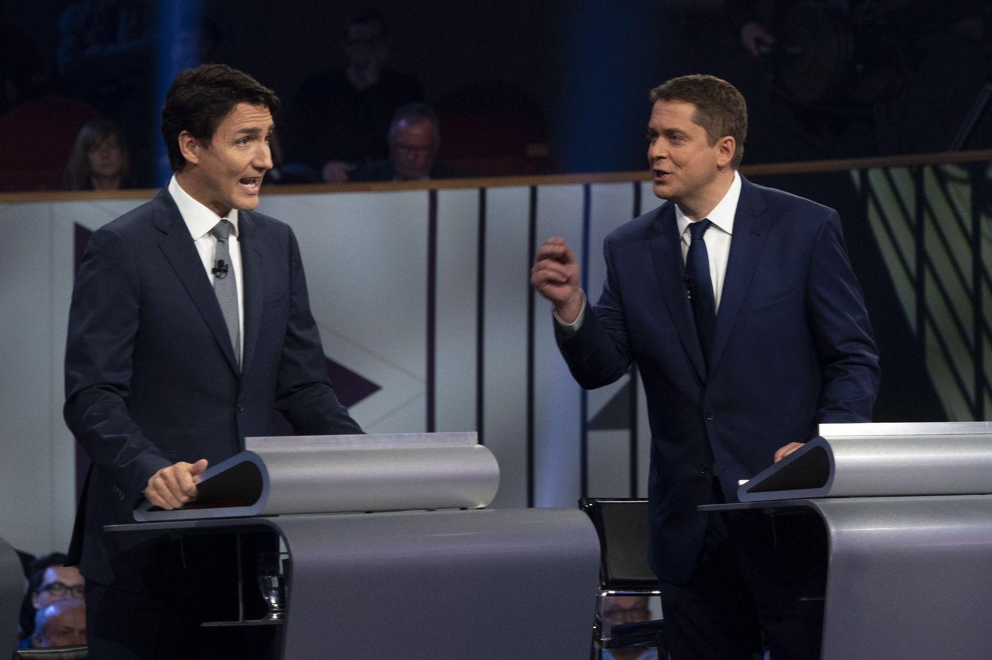 Kanadan pääministeri Justin Trudeau (vas.) ja konservatiivien puheenjohtaja Andrew Scheer sanailivat tiukasti vaaliväittelyssä Quebecin Gatineaussa 10. lokakuuta.