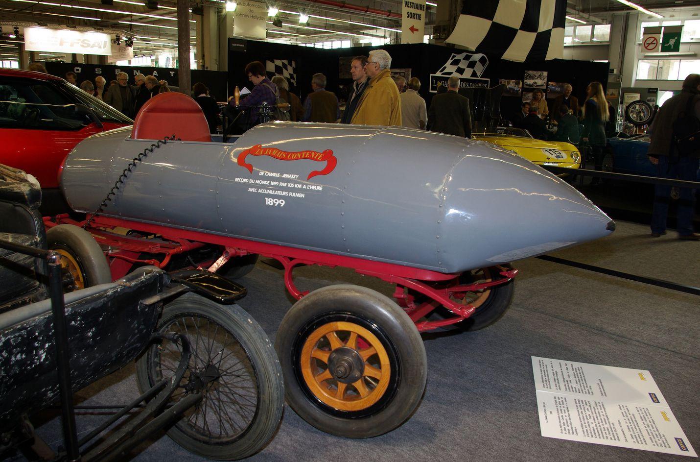 """""""Jamais contente"""" (ei koskaan tyytyväinen) ylitti ensimmäisenä autona maailmassa 100 kilometrin tuntivauhdin haamurajan. Voimanlähteenä toimi kaksi Postel-Vinay-sähkömoottoria, joiden kokonaisteho oli 50 kilowattia."""