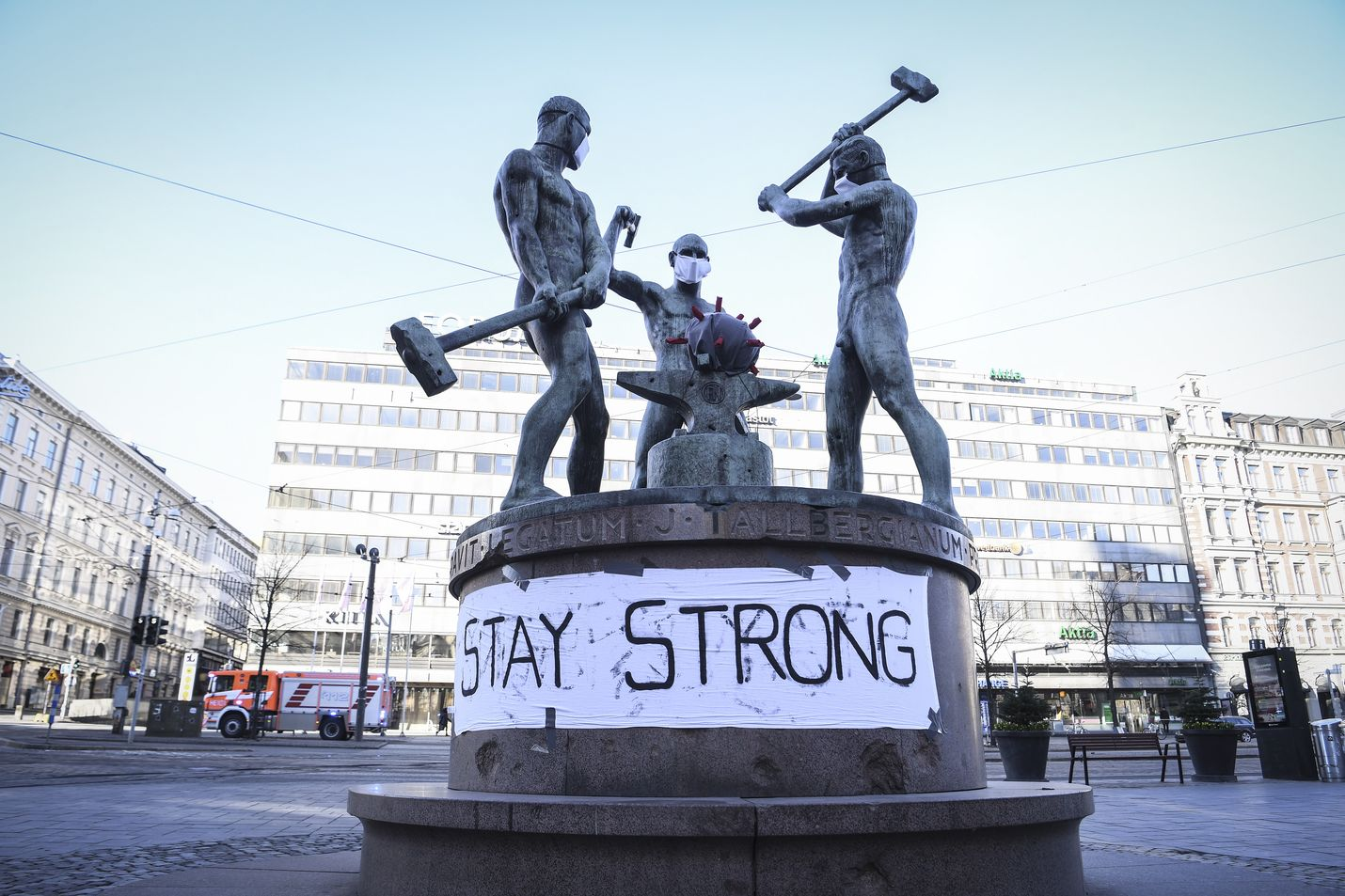 A banner at the Three Smiths Statue reads 'Stay Strong' in Helsinki, Finland, 31 March 2020. According to the Finnish Institute for Health and Welfare, THL, Finland has registered at least 1,615 COVID-19 cases, the disease caused by the novel coronavirus SARS-CoV-2.