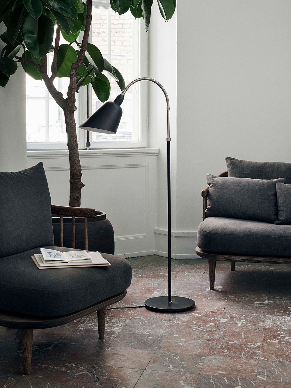 &Traditionin Fly SC1 lounge chairs in living room decor.