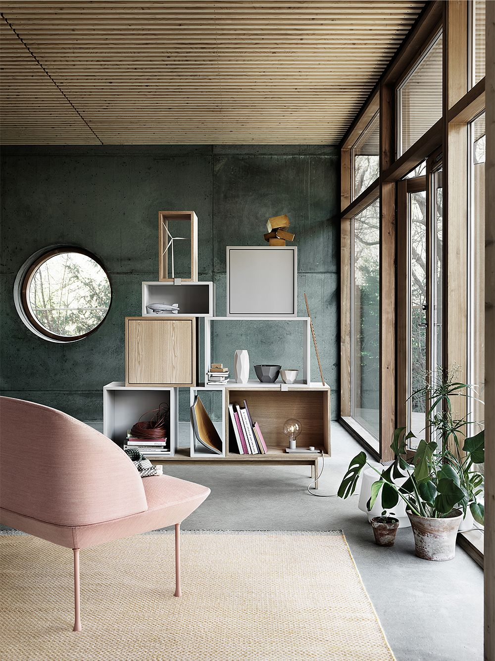 Muuto's Oslo lounge chair and Stacked shelving modules in living room decor.