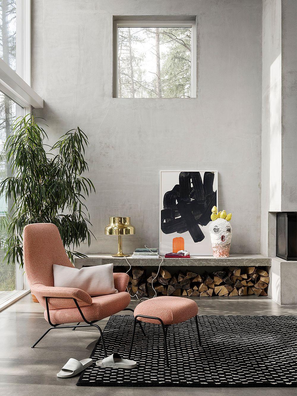 Hem's Hai lounge chair and Hai ottoman in living room decor.