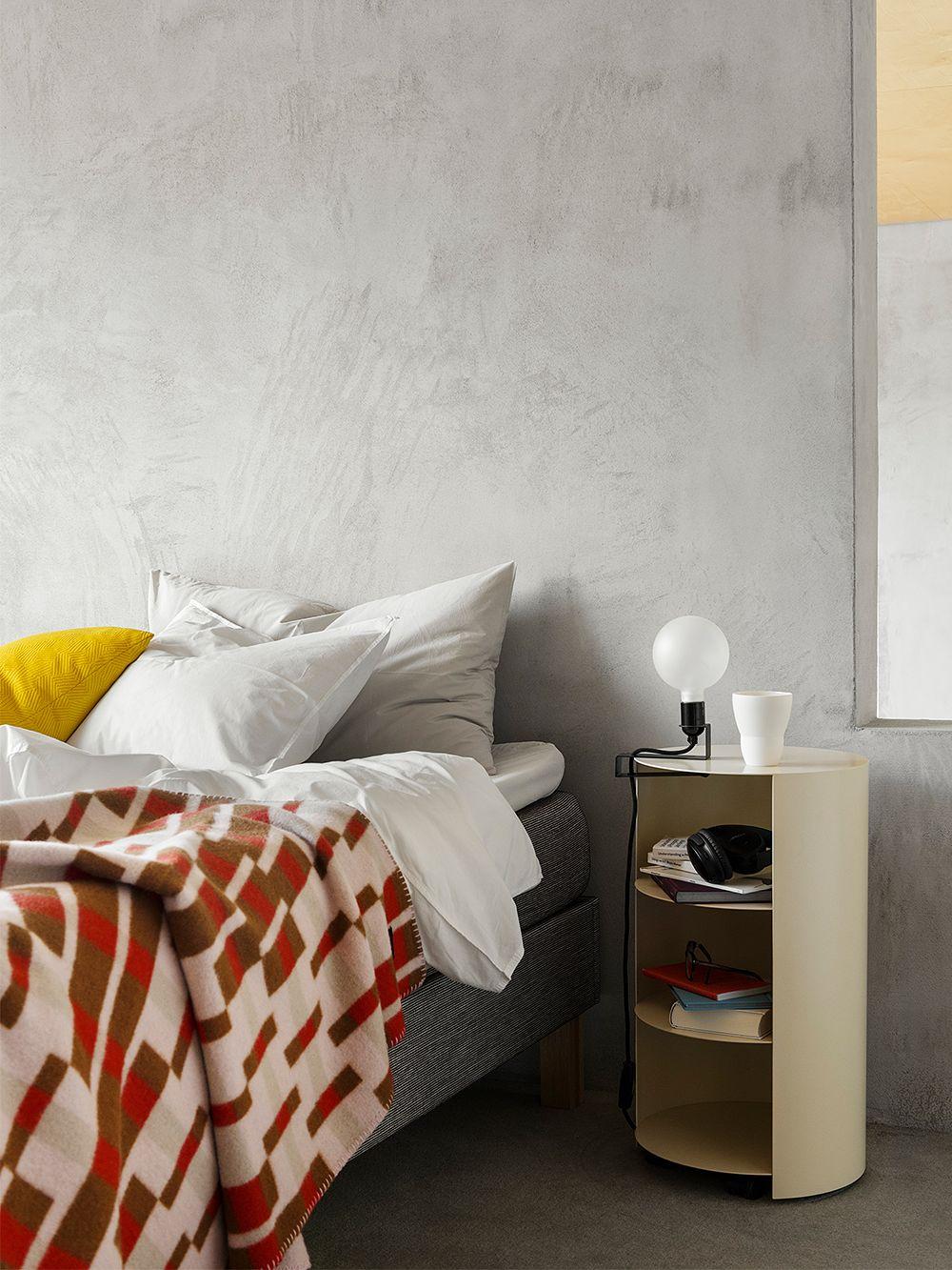 Hem's Vienna throw and Hide pedestal in bedroom decor.