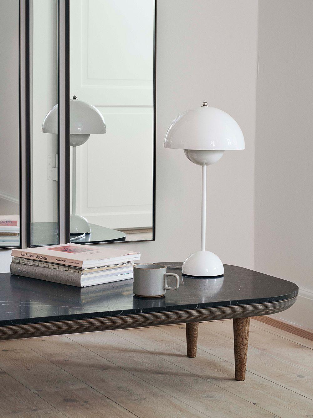 &Tradition's white table lamp, Flowerpot VP3, in living room decor.
