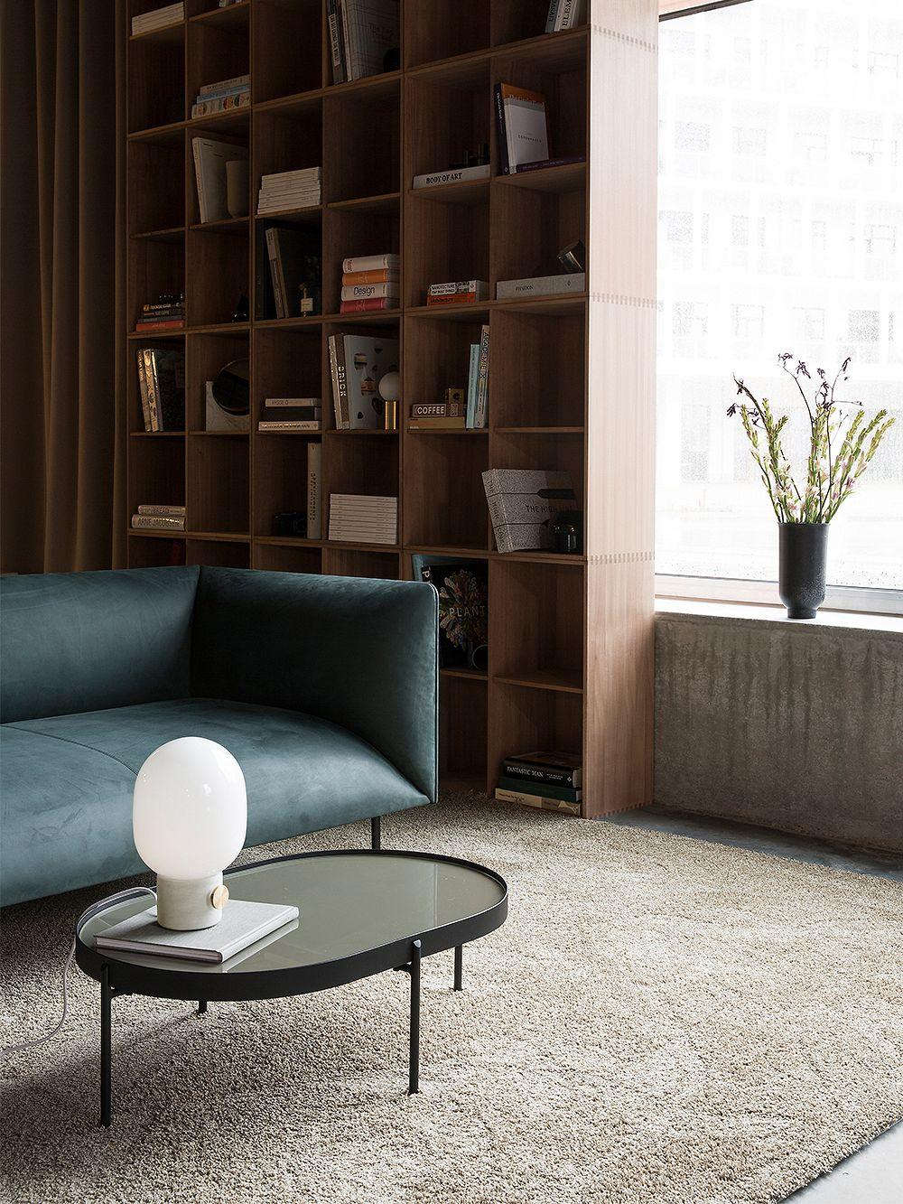 Menu's white table lamp, JWDA, in living room decor.