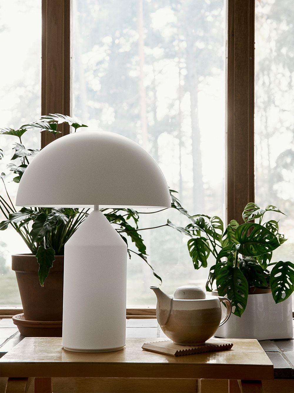 Oluce's white table lamp, Atollo 235, in living room decor.