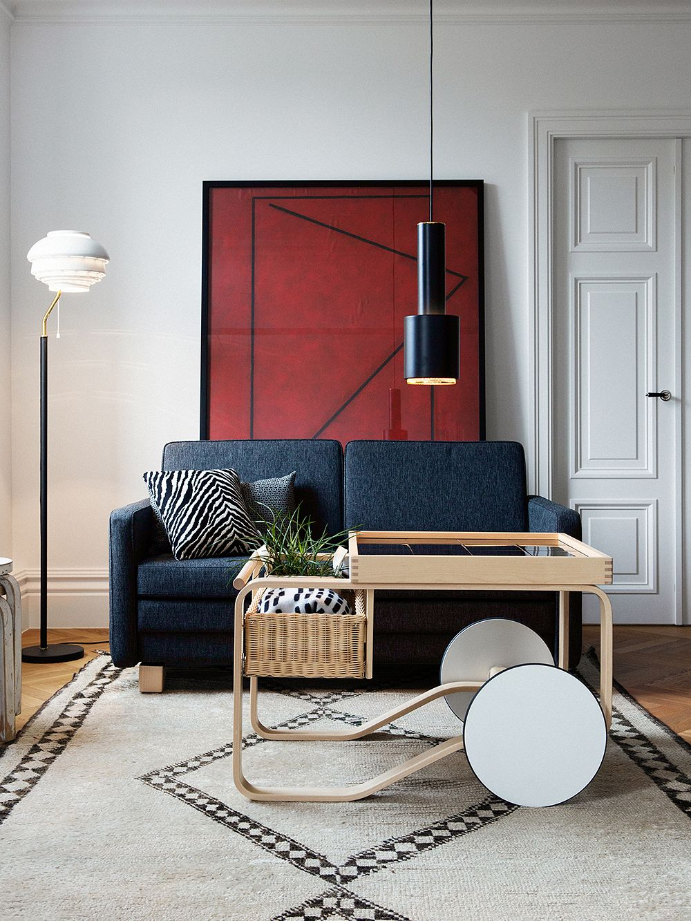 Alvar Aalto's designs A110, A808 and the Tea trolley in a living room setting.