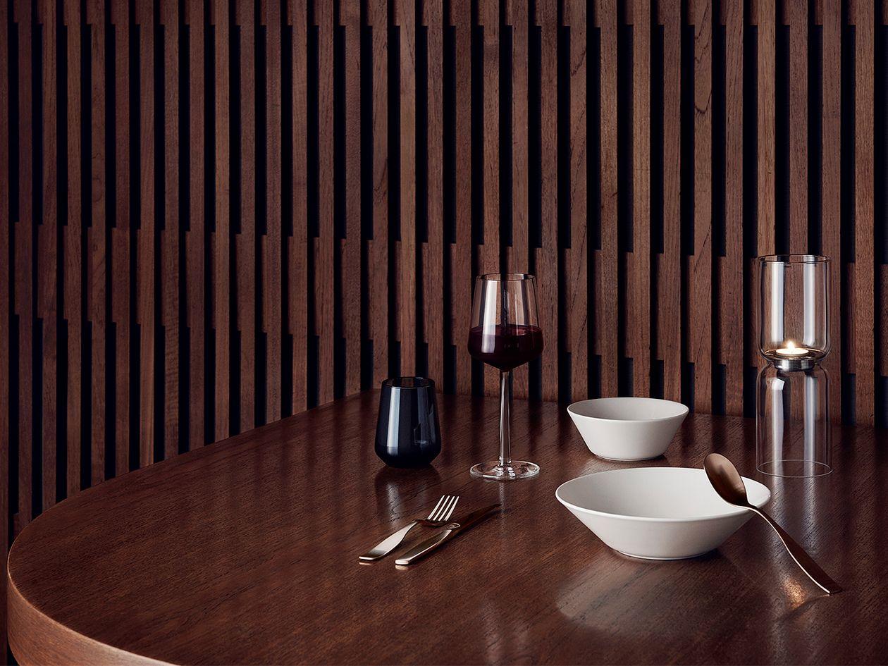 A table setting featuring Iittala's Teema tableware and Essence wine glasses.