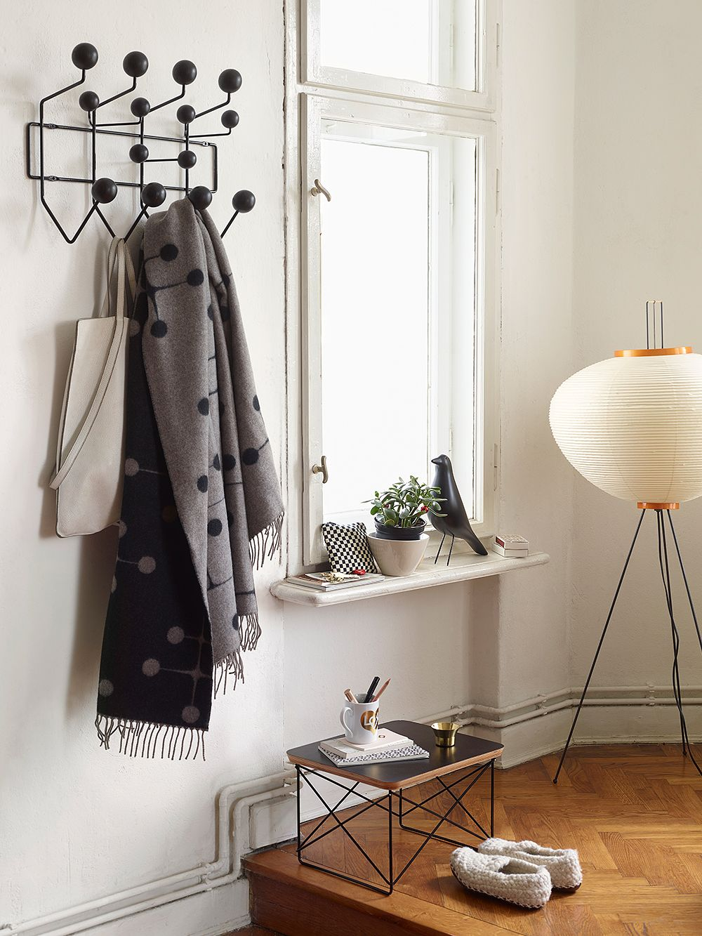 Vitra's Hang It All rack, Occasional coffee table and Akari floor lamp in a hallway setting.