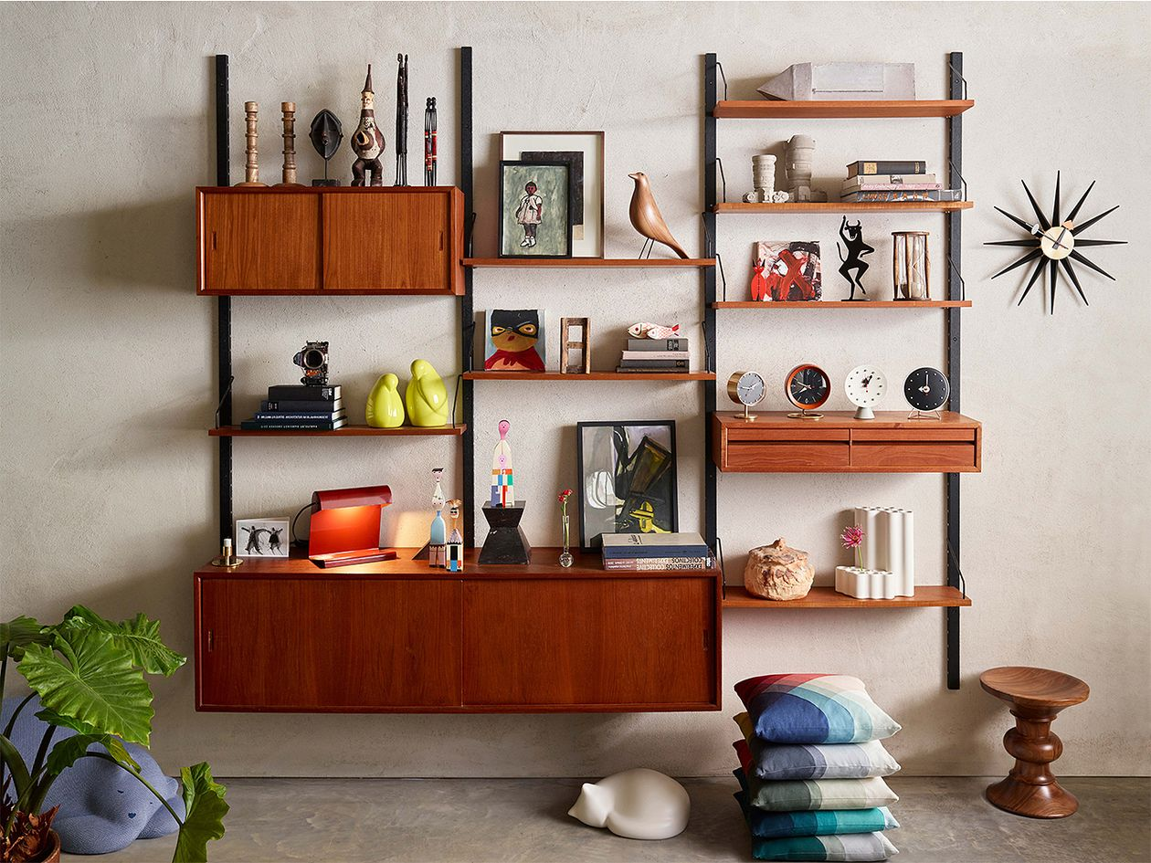 Decor items by Vitra displayed in an open shelving unit.