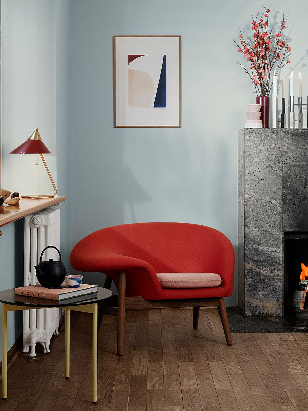 Warm Nordic's Fried Egg chair and Brass Top table lamp in a living room setting.