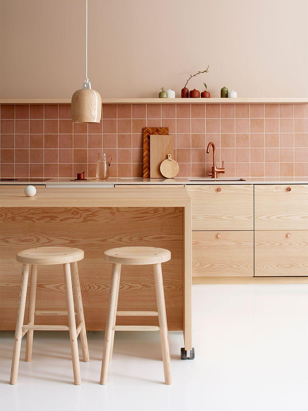 Nikari's Storia stool around a kitchen island.