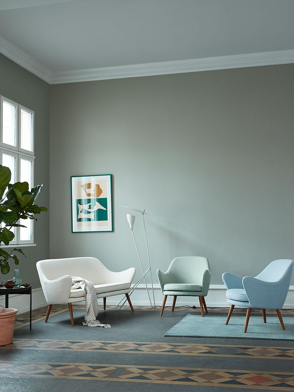 Warm Nordic's Dwell couch and Dwell armchairs in a living room setting.