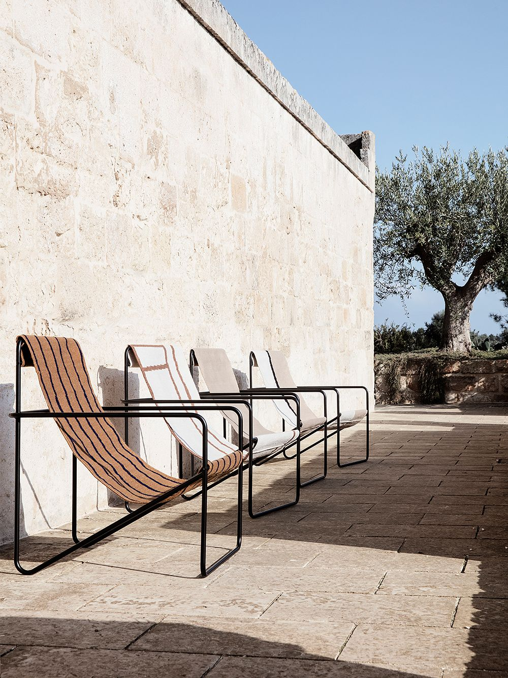 Ferm Living's Desert Lounge chairs outside.