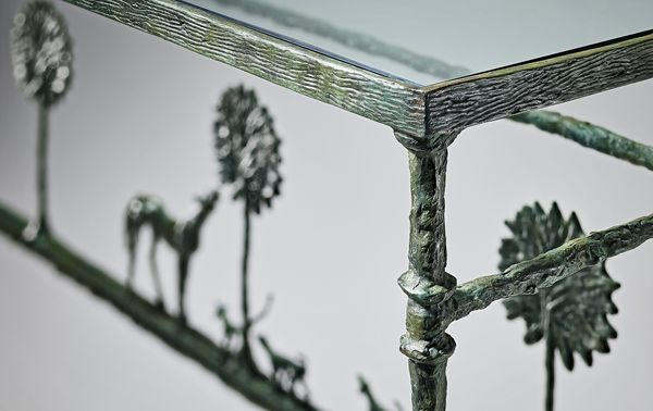 An implied landscape of three patinated trees, horse and dogs lends a unique decorative quality to this 1976 console table—one that is immediately identifiable as a bronze masterwork by Diego Giacometti.