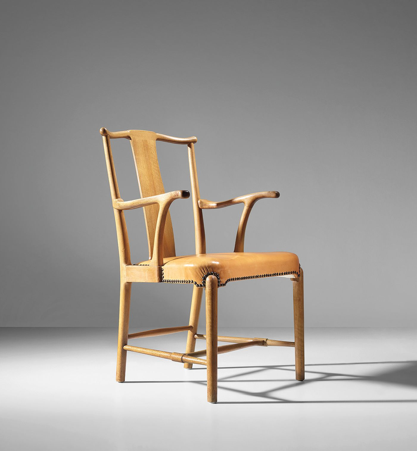 Reinterpreted from traditional Chinese models, Wegner's meticulous armchair design incorporates an integrated construction to achieve simplicity of form.