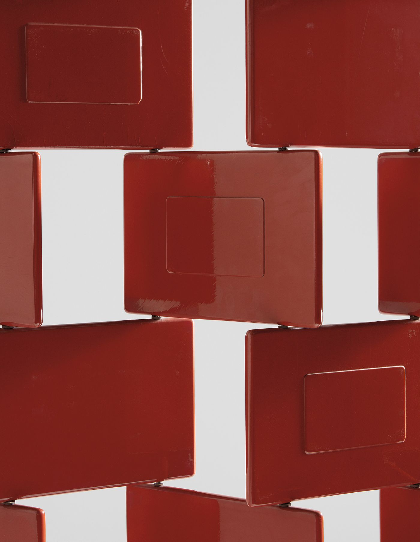 """A one-of-a-kind """"Brick"""" screen in red lacquer marks the Modernist's final burst of creativity in the 1970s, solidifying her status as the long-reigning empress of design."""