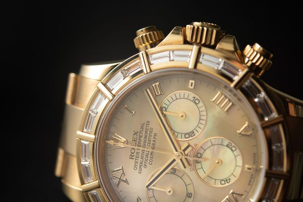 Lot 58 Rolex Daytona MOP and diamond bezel