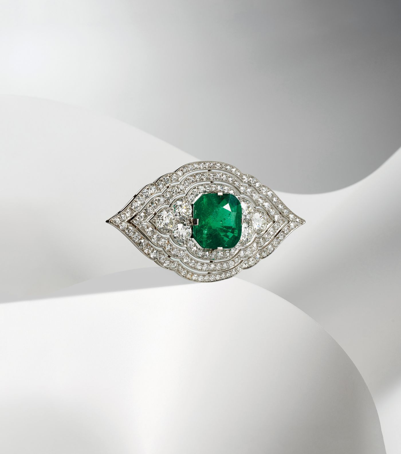 From the personal collection of a self-made New York millionaire, a Cartier emerald, diamond and platinum brooch sheds light on the jeweler's Art Deco design era. Susan Abeles, Senior International Specialist, provides an in-depth look.