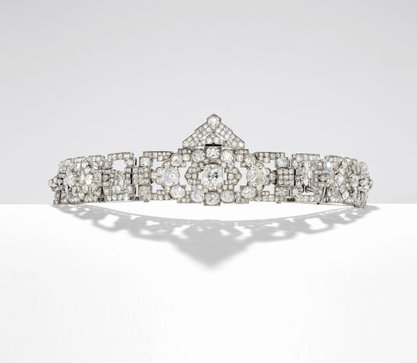 Senior Specialist and Vice President Alexis Vourvoulis illuminates two Cartier designs, a convertible tiara and a pendant watch, that were created to complement the changing fashions of the 1910s and 1920s.