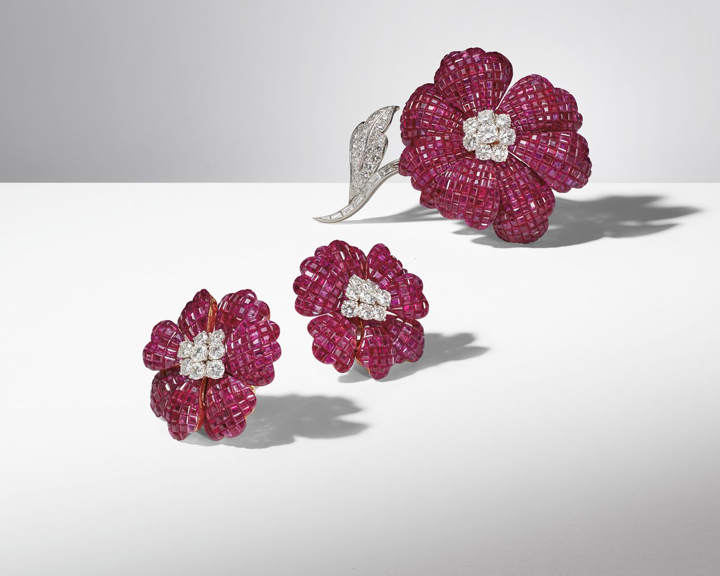 A brooch and pair of earrings in rubies and diamonds highlight the masterful craftsmanship synonymous with Alfredo Aletto and his family's business.