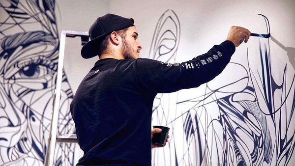 """A self-professed """"jack of all trades,"""" French artist Hopare began his career by spray-painting murals on the streets of Paris. He has since branched out into canvas, sculpture and other mediums."""