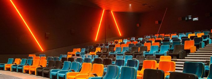 multicoloured cinema seats with red led lighting