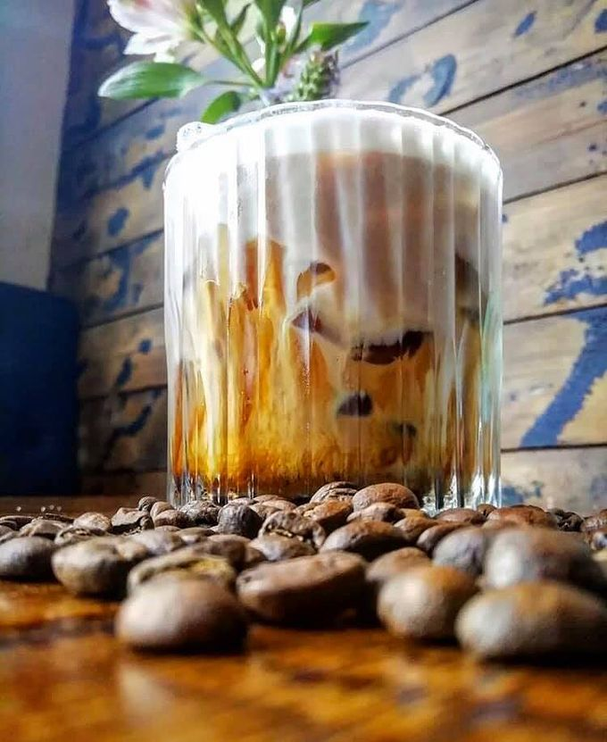 Iced Latte at Forum Kitchen & Bar with coffee beans located in Sheffield City Centre