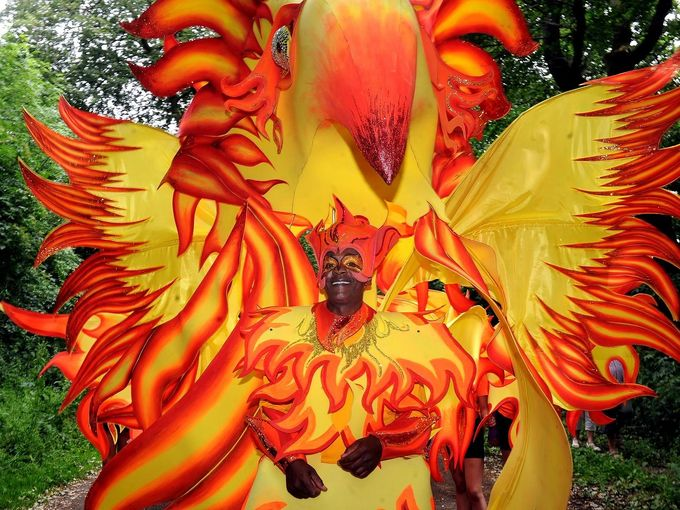 A person in a carnival costume of a phoenix taking part in the Sheffield carnival