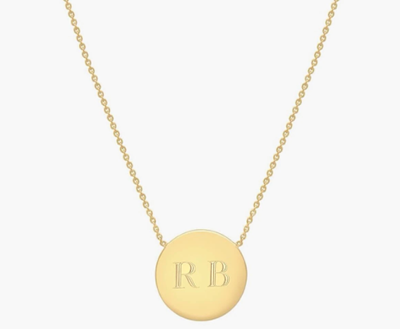gold necklace with round gold pendant with capital letters R and B engraved
