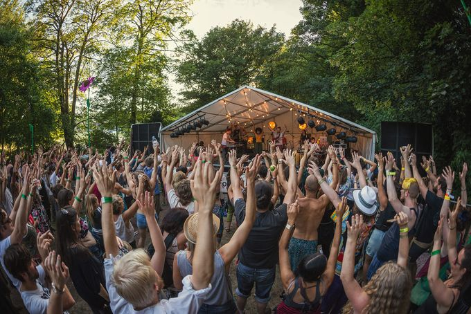 Crowd with their hands up in the woodland setting of The Folk Forest music festival in Sheffield City Centre