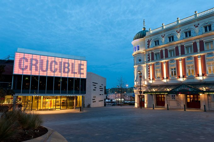 Night time image of the Sheffield theatres complex comprising of the crucible, lyceum and stage theatre in sheffield city centre
