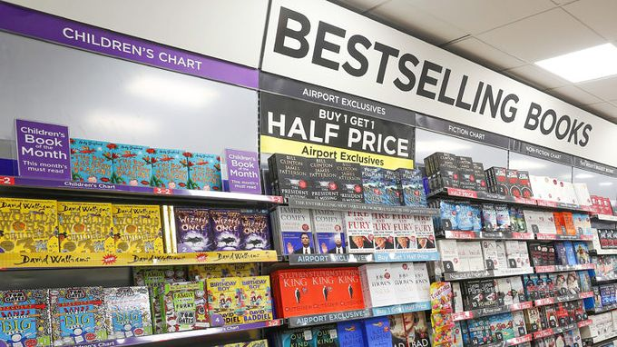 Shelves of books on a wall with bestselling books sign above it
